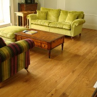 Solid English Character Oak over Underfloor Heating. Mild Antique stain and Hardwax Oil finish. Pictures taken one year